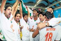 We've done it! Indian players celebrate their win over Belgium in Pune on Thursday.