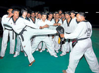 LESSONS FOR GLORY:  International taekwondo referee Choi Se Min (centre) giving lessons to coaches in Bangalore. DH PHOTO