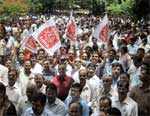 Bank employees and officers shout slogansdemanding hike in their salaries in Bangalore. PTI