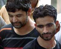 Hizbul Mujahideen militants Javed Ahmed (L) and Ashiq Ali (R) arrested by Delhi Police special cell in New Delhi on Friday. PTI