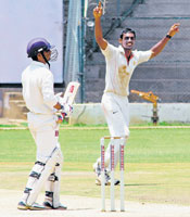 BIG SCALP: KSCA XI paceman A Mithun exults after getting rid of Ajay Ratra of ONGC in the KSCA all-India invitation tournament at the Chinnaswamy stadium on Friday. DH Photo