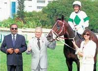 the winner Trainer S Padmanabhan (left), owners Zavaray S Poonawalla (second from left) and Behroze Z Ponnawalla (right) lead in Noble Prince (Wayne Smith up) after winning the Governor's Cup in Bangalore on Friday. DH photo