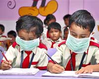 School children wearing protective masks in Ranchi on Thursday, after report of the first Swine Flu case in Jamshedpur, Jharkhand. PTI