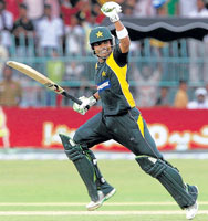 HEADY FEELING:Pakistani batsman Umar Akmal is over the moon after bringing up his maiden one-day hundred. Reuters