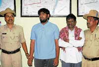Dr Venkatesh and Raghavendra arrested on charges of making threatening calls to CM's PA . DH Photo