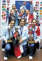 Winners: Egyptian girls display the spoils after winning the girls' title in the World junior squash championship. PTI