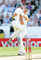 Over The Moon: An ecstatic Simon Katich congratulates Mitchell Johnson after the latter cleaned up Graham Onions to help Australia complete an innings win in the fourth Test. AP