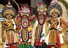 Decked up: Dancers dressed colourfully.