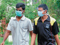 As a precautionary measures to prevent the spread of swine flu, NITK students were seen wearing mask in the campus on Monday. DH Photo