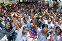 Students staging a protest against letting the Government Boys' Pre-University College ground to a private party to hold an expo, in Kolar, on Tuesday. DH PHOTO