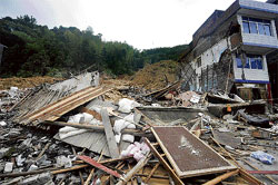 Wreckage: A landslide site triggered by deadly typhoon Morakot in Pengxi Township of east China's Zhejiang Province where at least six buildings with an unknown number of residents were burried on Tuesday. AP