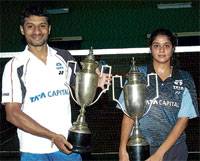 Victorious Duo: Mohit Kamat and Monisha Vinayak display their spoils at the MS Ramaiah Anandashram State-ranking badminton tournament in Bangalore on Tuesday. DH photo