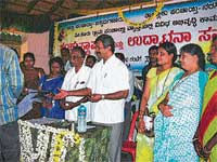 MLA D N Jeevaraj speaking after laying foundation stone for various development projects, in Nagaramakki on Tuesday.