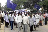 The members of Karnataka Dalit Sangharsha Samiti (Ambedkar) and physically challenged people taking out a protest rally in Chikkaballapur on Wednesday urging the government to solve the problems faced by them. dh photo