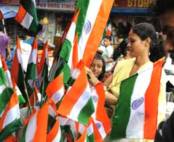 People buy national flags at a roadside shop in Siliguri on Thursday. AFP
