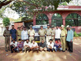 Arrest Circle Inspector Sampath Kumar and others with the gang of dacoits which hatched a plan to loot a vehicle near Malur Industrial area. The accused (seated L to R) Prabhakar, Santhosh, Vajaresh, A R Naveen, Satish, Siddaraju and Raju. DH photo