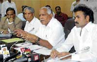 (From L) Principal Secretary to CM V P Baligar, Minister for Medical  Education Ramachandra Gowda, Chief Minister B S Yeddyurappa and Minister for Health and Family Welfare Sriramulu at a meeting on influenza A (H1N1) in Bangalore on Friday. Dh Photo