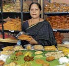 Manjula Seshadri poses with her delicacies. DH PHOTO dinesh S K