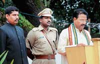 District-in-Charge Minister J Krishna Palemar speaking at the Independence Day celebrations at Nehru Maidan in Mangalore on Saturday.  Deputy Commissioner V Ponnuraj and Superintendent of Police Dr A S Rao look on. DH Photo