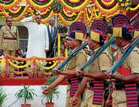 Minister for Fisheries Anand V Asnotikar receiving the guard of honour at the Independence Day parade at Chikmagalur on Saturday. DH Photo
