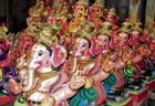 awaiting customers: Ganesha idols put up for sale at a shop in Kataripalya in Kolar. dh photo