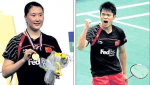 Lan Lu shows off her gold medal after winning the women's crown. RIGHT: Lan Din celebrates after sealing his third consecutive men's title. DH Photos / Kishor Kumar Bolar