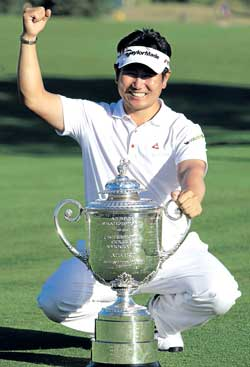 Yang Yong-eun with the US PGA Championship trophy on Sunday. AP