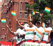 Indian Americans cheer during parade