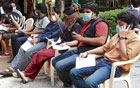 long wait: People waiting for a check-up at outside the H1N1 flu ward at the Rajiv Gandhi Institute of Chest Diseases (RGICD) in Bangalore on Tuesday. DH PHOTO