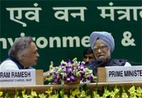 Prime Minister Manmohan Singh with Union Minister of State for Environment and Forests (Independent charge) Jairam Ramesh at the inauguration of National Conference of Ministers of Environment and forests from States and UTs in New Delhi on Tuesday. PTI