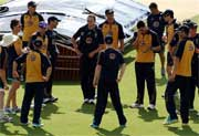 Australia hold a team talk during their cricket practice session at the Oval. AP