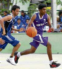 Darshan of Young Orions (right) dribbles along as Tofiq of Rovers tries to catch up. DH PHOTO