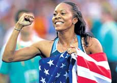 American Sanya Richards exults after clinching the women's 400M gold at the Olympic stadium in Berlin on Tuesday. AP