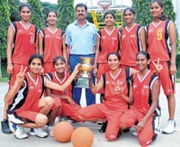 VICTORIOUS: Sports Hostel, Mysore, winners of the girls' State Junior basketball title on  Saturday. STANDING (from left): Navaneetha, Jagadambika, MB Patel (coach), Thangamma, Maduri and Preethi. SQUATTING: Nayana, Noorjahan, Sushmitha and Victoria. DH photo