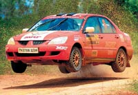 RED HOT: Arjun Balu (co-driver Sujith Kumar) in full steam on the second day of the K-1000 rally on Saturday. DH Photo