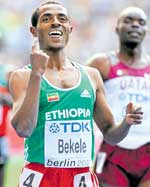 NUMERO UNO: Ethiopian Kenenisa Bekele exults after winning the 5000M gold on the  concluding day of the World Championships in Berlin on Sunday . AFP