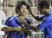 India's Baichung Bhutia celebrates with teammate Steven Dias, right, after scoring a goal. PTI