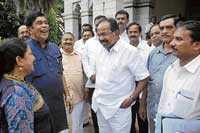 Former Union Minister Oscar Fernandes and Union Minister Veerappa Moily along with the members of the Chikkaballapur Zilla Panchayat, during a meeting to discuss on the development works of Chikkaballapur constituency in Bangalore on Wednesday. dh Photo