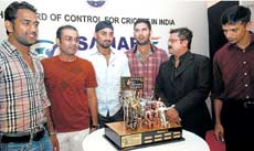 OBJECT OF DESIRE: Mahendra Singh Dhoni, Virender Sehwag, Harbhajan Singh, Yuvraj Singh and Rahul Dravid eye the  BCCI Corporate Trophy as Sahara's head of corporate communications, Abhijit Sarkar, looks on on Thursday. DH photo