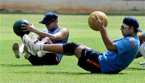 Rahul Dravid and Yuvraj Singh exercise during a practice session