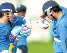 MASTER'S TIPS: Sachin Tendulkar (left) explains a point to Suresh Raina at the preparatory camp on Friday. DH Photo