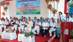 Union Minister of State for Railways K H Muniyappa speaking after flagging off Mangalore-Bangalore day train in Mangalore on Saturday. Union Minister for Law and Justice M Veerappa Moily and others are seen. DH Photo
