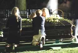Edward Kennedy laid to rest near slain brothers