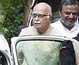 BJP leader L.K.Advani leaves after a meeting with RSS chief, Mohan Bhagwat, in New Delhi on Saturday. AP