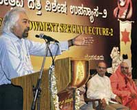 National Knowledge Commission Chairman Sam Pitroda delivering the second Golden Jubilee Endowment Lecture, in Bangalore on Sunday. Commission Advisor R Raghunathan and Seer Shivratri Deshikendra Swamiji are seen. DH PHOTO