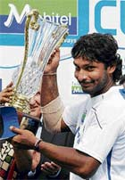 Symbol Of Supremacy: Kumar Sangakkara with the trophy after Sri Lanka's 2-0 Test series win over New Zealand. AFP