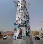 Posters of presidential and provincial council candidates are pasted on a power pillar in Kabul, Afghanistan on Monday. AP