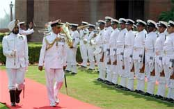 New Chief of Naval Staff Nirmal Verma inspects the guard of honour in New Delhi on Monday. PTI