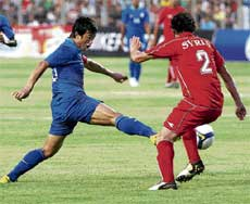 Red Means Stop: Syria's Belal Abdul tries to check Indian captain Bhaichung Bhutia in the Nehru Cup final in New Delhi on Monday. PTI