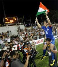 Indian captain Bhaichung Bhutia celebrate after defeating Syria in the final match of the Nehru Cup football tournament in New Delhi on Monday.